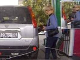 hilarious moment woman driver fills up the wrong car at petrol station ... and thinks she's being pranked by the real owner